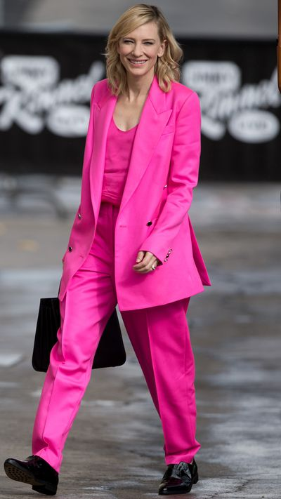 In a power pink <strong>Edun </strong>suit.