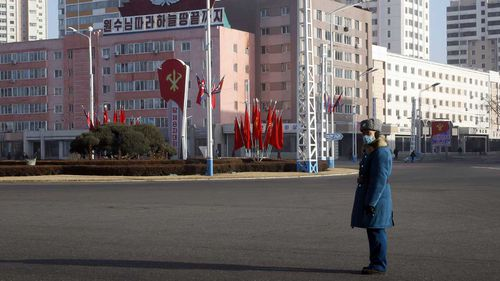 A traffic officer stand in attention along a main street of the Central District in Pyongyang.