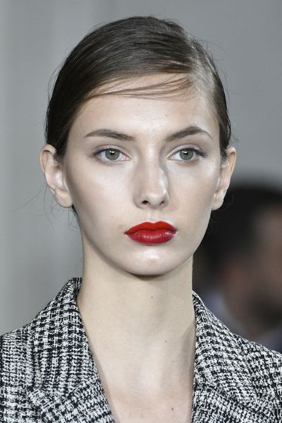 Glowing skin and a perfect red lip for Jason Wu.