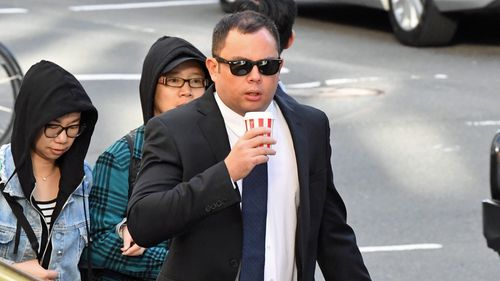 Ian Juurik arrives at the Downing Centre Courts, Sydney, Monday, April 1, 2019. Garbage truck driver Ian Juurik has pleaded not guilty to negligent driving causing death after he ran over a homeless man in Redfern in May 2018.