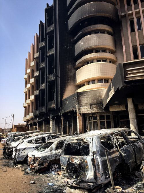 Bombed car wrecks and damage outside the Cappuccino cafe in Ouagadougou, following a terror attack in Burkina Faso