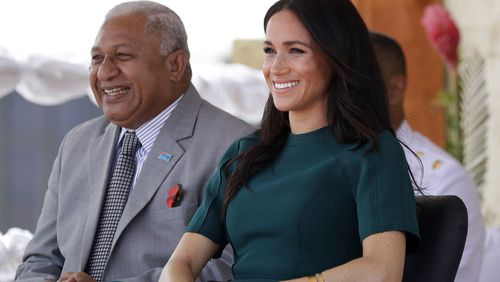 Meghan, Duchess of Sussex, seen with tag dangling from dress in Tonga