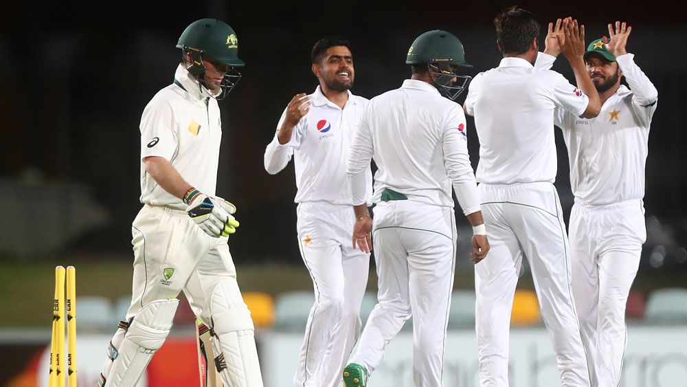Pakistan celebrate after taking a wicket against the Cricket Australia IX in Cairns.(Getty)
