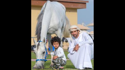 The page shows the Sheik and little afro-haired Mohammed enjoying fishing trips and hanging out with giraffes and the Dubai royal family's prized racehorses. <p></p><p></p>
