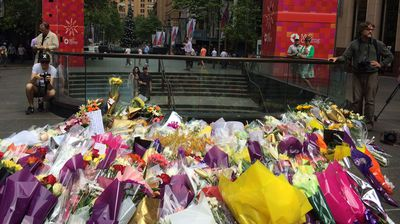 A sea of flowers rests on the pavement in Martin Place. (Supplied)