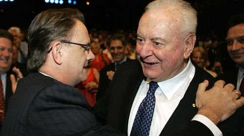 Mark Latham embraces former Prime Minister Gough Whitlam at an event. (Getty)