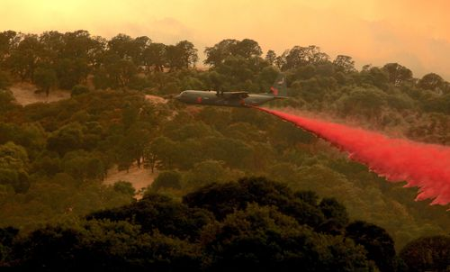 A C-130 Modular Airborne FireFighting Systems plane drops retardant on the River Fire portion of the Mendocino Complex Fire in Lakeport, California, USA, 29 July 2018 (issued 30 July 2018). The River and Ranch fires combined as the Mendocino Complex Fire with more than 56,000 acres (22,660 hectares) burned, nearly doubling since Sunday with more than 10,000 people already evacuated. EPA/ALAN SIMMONS