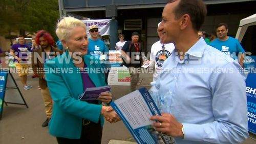 Independent Kerryn Phelps and Liberal Dave Sharma shake hands on voting day.