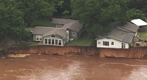 Waterlogged parts of the central US were bracing for more rain, following days of severe storms that have battered Iowa, Kansas, Missouri and Oklahoma.  (KOCO-5 via AP)
