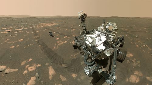 Just days after NASA's Perseverance rover gently dropped the Ingenuity helicopter on the surface of Mars, the robot companions took a selfie together on Tuesday and beamed it back to Earth.