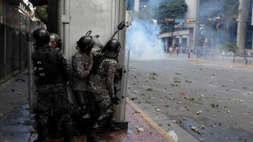Police fired tear gas against anti-government protesters.