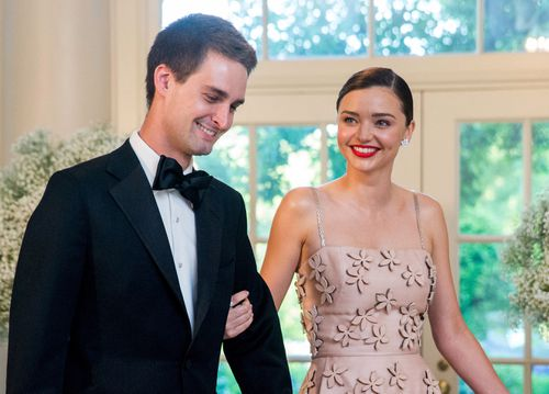 Miranda Kerr (right) got hitched to Snapchat billionaire Evan Spiege. (AAP)