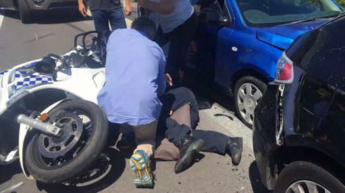 The male officer was treated at the scene by an off-duty doctor before NSW Ambulance arrived.