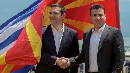 Greek Prime Minister Alexis Tsipras, left, and  Macedonia Prime Minister Zoran Zaev shake hands. (AP).