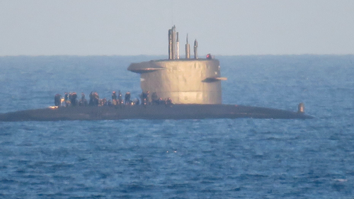 A local took this photo as the submarine drifted by the town.