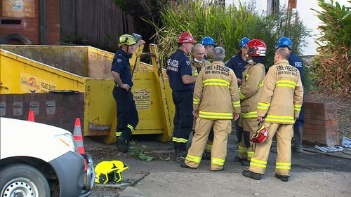 It was a long and difficult process for fire crews, as Mr Eisler's home was full to the ceiling with books and furniture making it hard to enter. (9NEWS)