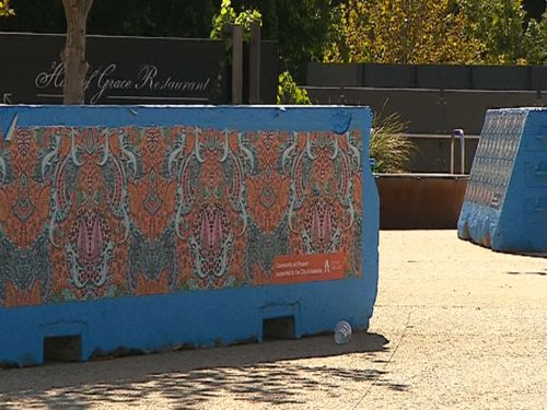 The 'temporary' barriers are still in place at the venue. (9NEWS)