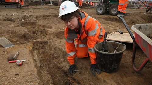 Helen Wass, Head of Heritage at HS2, over the burial site.