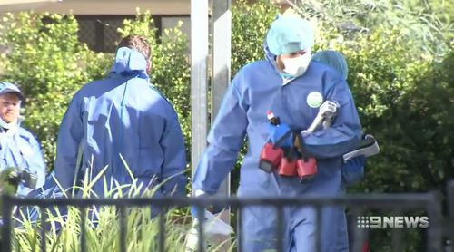 Forensic officers were seen walking in and out of the Toowoomba property. (9NEWS)