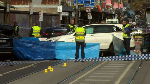 The woman was pinned against another vehicle, suffering catastrophic injuries. She died at the scene. (9NEWS)