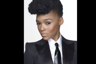 She's still girly as they come - but you'll never catch super-slick soulstress Janelle Monae in a frock!