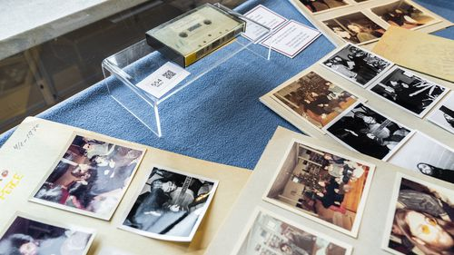 A view of photos and a cassette with the recording of four Danish schoolboys' interviews with John Lennon and Yoko Ono during the famous couple's winter stay in Thy, in Jutland, Denmark.