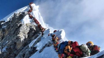 A long queue of mountain climbers line a path on Mount Everest, in this photograph that made headlines around the world.