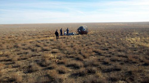 The Soyuz MS-10 space capsule lays in a field after an emergency landing near Dzhezkazgan, about 450 kilometres from the launch site.
