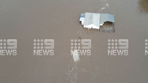 House floats off in Taree, NSW flood.
