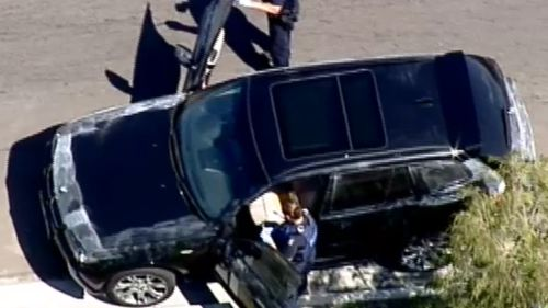 Police investigating the allegedly stolen BMW. (9NEWS)