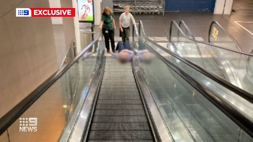 Woman trapped in escalator robbed while she waited to be freed