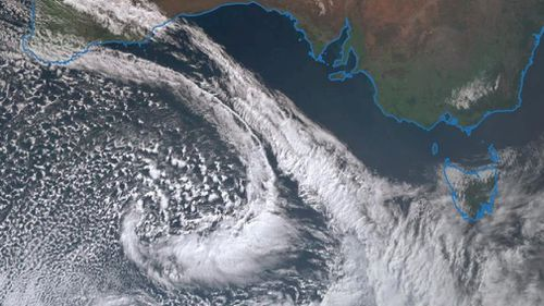 A cold front and trough building off the south coast of Australia.
