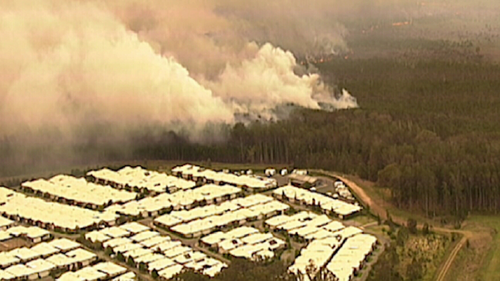 9News was told the fire has burnt right up to gardens in some homes at Lakes Innes and Lake Cathie.