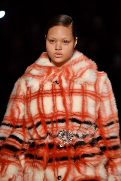 Miu Miu's fur game is strong, with thisbold print accessorised with a chic broochthat will never make for boring winter attire.
