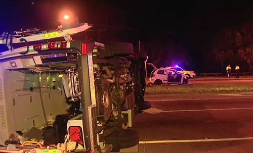 The crash in Dianella last week caused the ambulance to roll on its side. Picture: 9 News