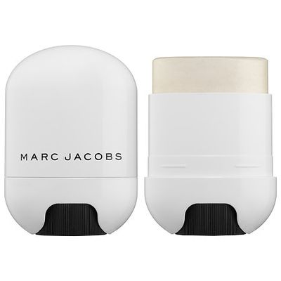 """There are so many terrible illuminators out there – too glittery, too icy, too sticky, too pink, not lasting… we could go on. This one by Marc Jacobs made its debut on the Marc Jacobs runway a few seasons back and it is none of those things. Instead, you'll find a perfectly dewy finish that strikes a nice balance between frost and sheen and can be applied with a brush or fingertips. Even though it does sell itself as a """"universal shade"""", it really is best for lighter skin tones. Those with dark skin should opt for a more golden shade. <br />"""