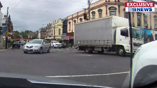 Dashboard camera footage from a nearby car shows the truck rolling backwards into oncoming traffic. (9NEWS)