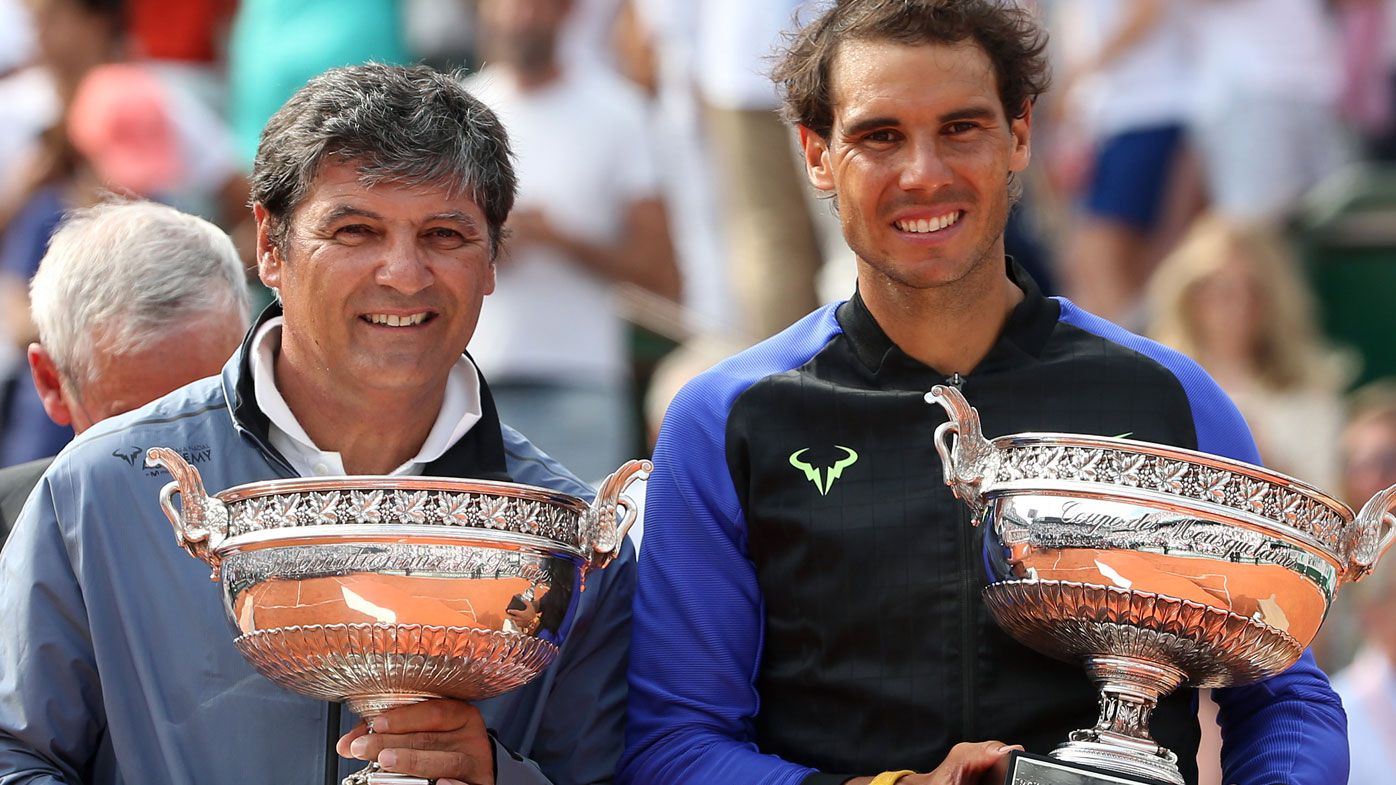 Toni Nadal and Rafael Nadal celebrate at the 2017 French Open. (Getty)