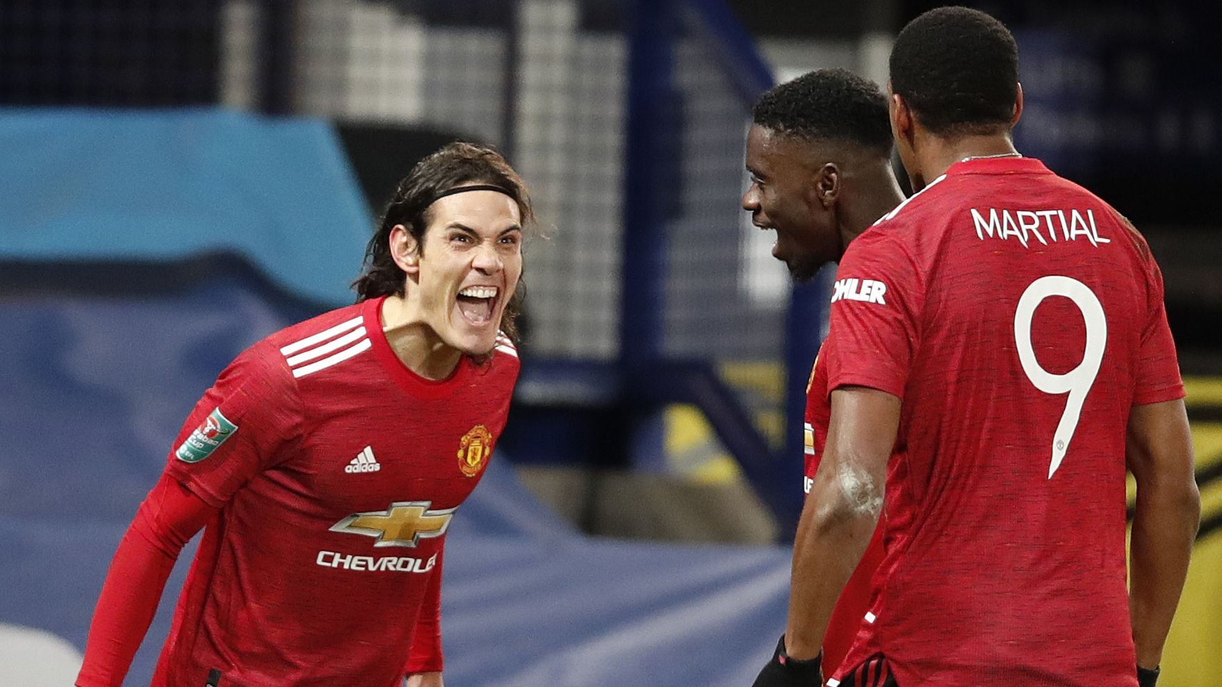 Edinson Cavani of Manchester United celebrates with Axel Tuanzebe and Anthony Martial.