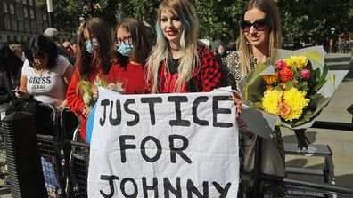 US Actor Johnny Depp supporters wait for the actor to arrive, outside the High Court in London, Tuesday, July 28, 2020.
