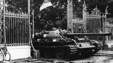 A North Vietnamese communist tank driving through the main gate of the presidential palace of the US-backed South Vietnam regime as the city falls into the hands of communist troops in 1975. (Getty Images)
