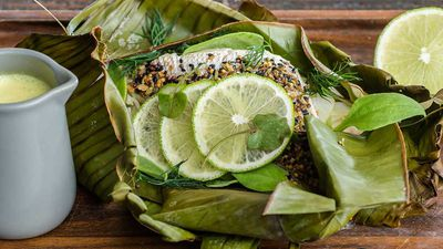 Indu's whole snapper baked in banana leaf with five-spice, string hoppers and coconut moilee