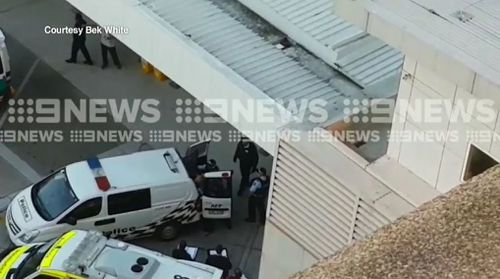 Vision obtained by 9NEWS shows the gunman being taken into the back of a police van. Picture: 9NEWS