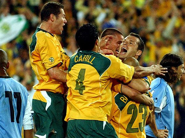 The Socceroos swamp Mark Bresciano in 2005. (AAP)