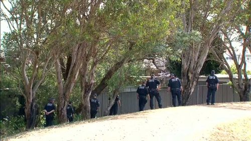 A large police contingent have scoured neighbouring lawns. (9NEWS)