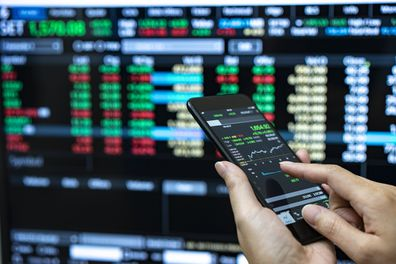 Person checking stock market investments on phone