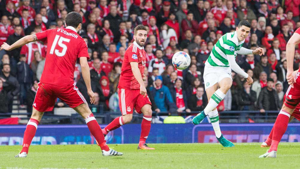 Rogic scores as Celtic claim League Cup