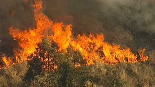 Wind speeds in excess of 45km/h are expected to make containment efforts more difficult as firefighters battle up to 75 blazes.