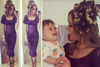 Footy WAG Rebecca Judd seems to have a fan in son Oscar. Outfit for the day? A Dolce and Gabbana dress and bag, a Hatmaker fascinator and Giuseppe Zanotti shoes.<br/><br/>Image: Instagram