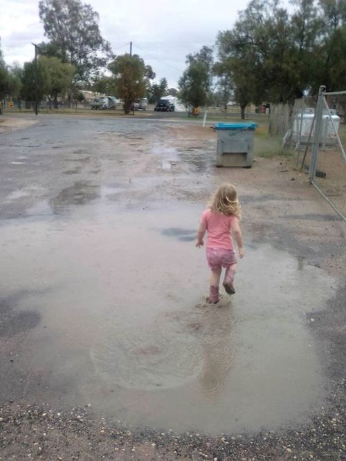 Nikki Jane shared a picture of a young girl in gumboots stomping in a puddle after this week's heavy rain.